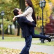Стоковое фото: Adult couple having a good family day in the park
