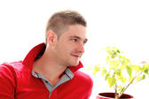 Man in red shirt is happy on this sunny day — Stock Photo
