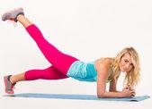 Beautiful blonde exercising — Stock Photo