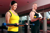 Couple working out in a fitness gym — Stock Photo