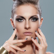 Stock Photo: Beautiful young womwith evening makeup