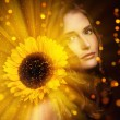 Very sexy woman show her natural look with a sunflower — Stock Photo #37627023