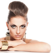Beautiful young woman with evening makeup — Stock Photo