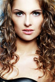 Woman with curly hair and naked shoulders — Stock Photo
