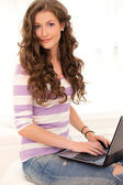 Beautiful girl with a laptop — Stock Photo