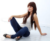 Girl with long hair sitting on the floor — Stock Photo