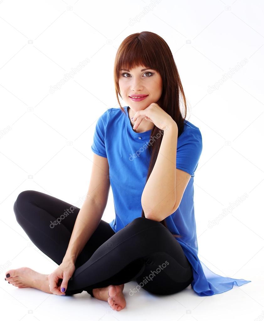 Woman in leggings sitting on the floor stock photo for On the floor on the floor