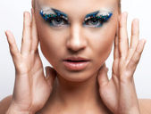 Beautiful caucasian woman with artistic makeup — Stock Photo