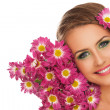 Beautiful woman with flowers in hair — Stock fotografie #38088317
