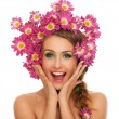 Beautiful woman with flowers in hair — Stock fotografie
