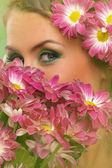 Beautiful woman with makeup and flowers — Stock Photo