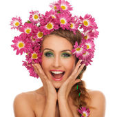 Beautiful woman with flowers in hair — Stock Photo