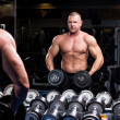 Stock Photo: Muscular man in a gym