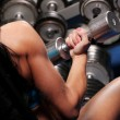Foto Stock: Muscular beautiful womat gym