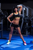 Beautiful woman working out in a gym — ストック写真