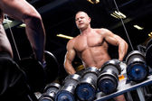 Muscular man in a gym — Stock Photo