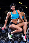 Beautiful woman working out in a gym — Stock Photo