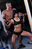Beautiful muscular couple at the gym — Stock Photo