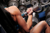 Muscular beautiful woman at a gym — Stock Photo