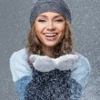 Cute girl with snowflakes having a good time — Stock Photo #38378871