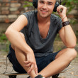Handsome guy sitting in the street — Stock Photo #38379449