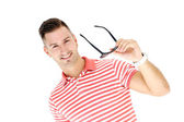 Man in striped shirt posing — Stock Photo