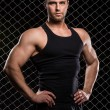 Strong man and his muscles — Stock Photo