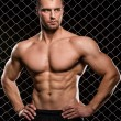 Strong man and his muscles — Stock Photo #39744661