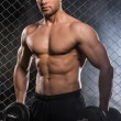 Stock Photo: Muscular mwith dumbbell