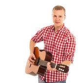 Молодой музыкант с гитарой — Стоковое фото