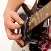 Young musician holding electro guitar — Stock Photo