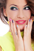 Girl has colored nails and makeup — Stock Photo