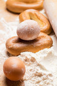 Bunch of eggs in flour — Stock Photo