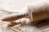 Rolling pin in flour — Stock Photo