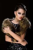Beautiful girl wearing fur — Stock Photo