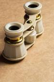 White binoculars on the table — Stock Photo