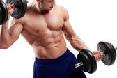 Bodybuilding. Strong man with a dumbbell — Stock Photo