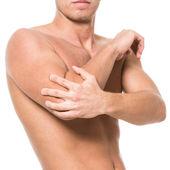 Mann hat schmerzen in den ellbogen — Stockfoto