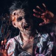 Stock Photo: Creepy scary zombie