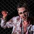 Creepy zombie in handcuffs — Foto de stock #39834369