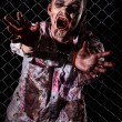 Stock Photo: Creepy zombie in handcuffs