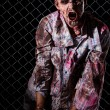 Creepy zombie in handcuffs — Foto de stock #39834379
