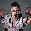Aggressive, creepy zombie in clothes — Stock Photo #39834439