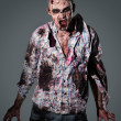 Aggressive, creepy zombie in clothes — Stock Photo #39834443