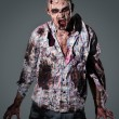 Stock Photo: Aggressive, creepy zombie in clothes