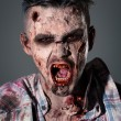 Aggressive, creepy zombie in clothes — Foto de stock #39834467