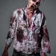 Aggressive, creepy zombie in clothes — Stock Photo #39834469