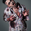 Aggressive, creepy zombie in clothes — Stock Photo #39834473