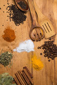 Spoon and heap of spices on the table — ストック写真