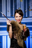 Girl with fur and champagne — Stock Photo